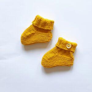 Okergele katoenen baby-slofjes