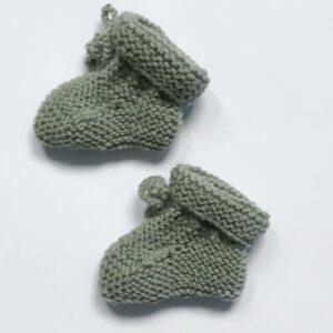 Groene vintage wollen baby-slofjes
