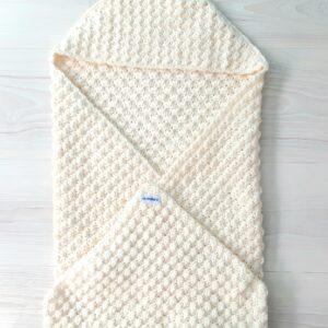Cremekleurige baby-omslagdoek